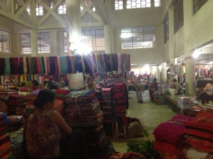 5-6 feet high stacks of gorgeous hand woven phaneks(Meitei sarong), shawls & Innaphis amongst other products!